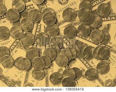 Dollar coins and banknotes currency of the United States useful as a background - vintage sepia look
