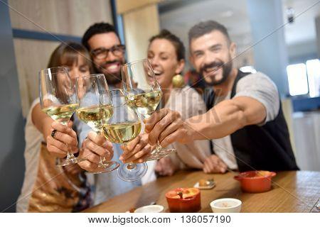 Portrait of friends in a bar drinking wine