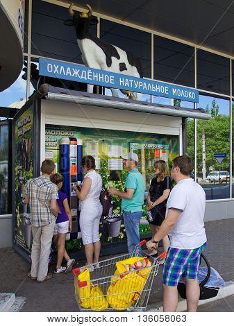 Voronezh, Russia - June 07, 2013, The queue at the vending machine for milk sale