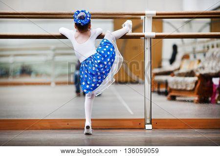 Little girl ballerina practicing in a dance class. Child girl dance. Preschool child taking dance lessons. Shallow depth of field. Selective focus.