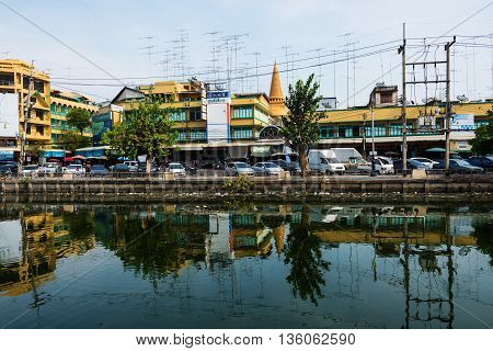 NAKHON PATHOM THAILAND - MAY 08 2016: fresh market near the canal and Phra Pathom Chedi.