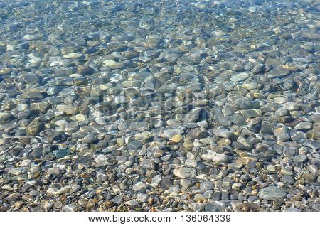 Natural Background, Stones Texture under a Transparent Sea Water