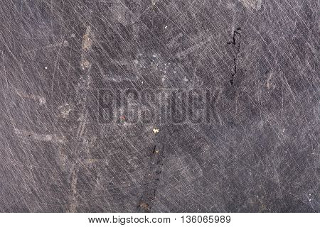 Obsolete scratched steel textured background. Grey color