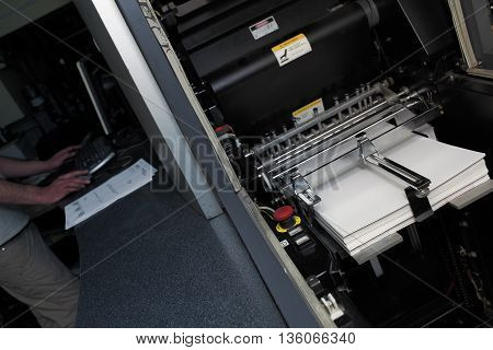 Digital offset press in the work process.
