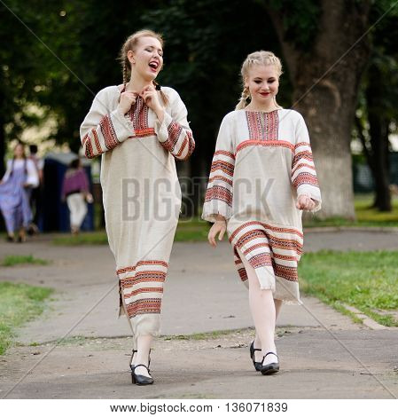 Orel Russia - June 24 2016: Turgenev Fest. Two smiling girls in traditional Russian dresses square