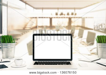 Workplace with blank white laptop screen coffee cup smartphone decorative plants in buckets and stationery items on blurry office background. Mock up 3D Rendering