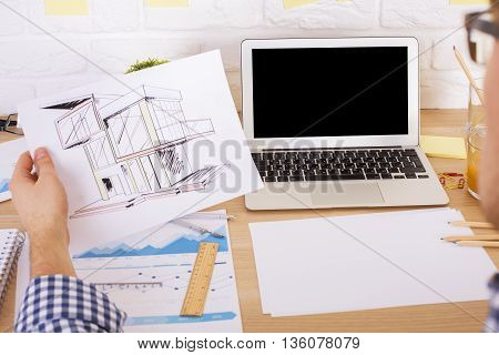 Architect Evaluating Project In Office