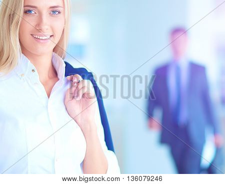 Yound woman drink coffee at office, standing .