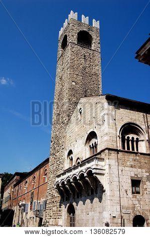 Brescia Italy - May 30, 2006: 13-17th centuries Broletto with its soaring stone 1187-1234 stone campanile the Tor del Pegol in the Piazza del Duomo
