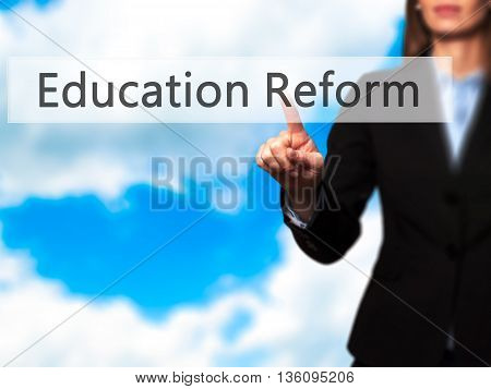 Education Reform - Businesswoman Hand Pressing Button On Touch Screen Interface.