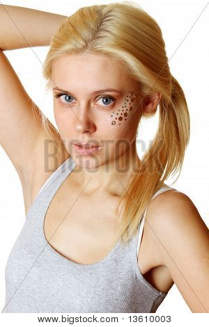 Beautiful woman with makeup and sequins
