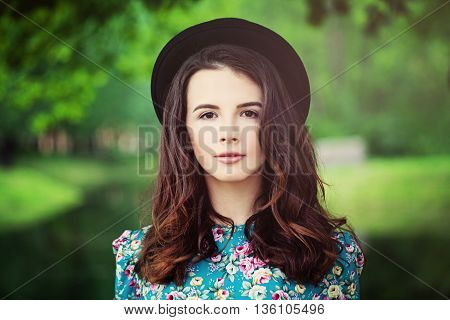 Fashion Model Girl on Green Background Outdoors