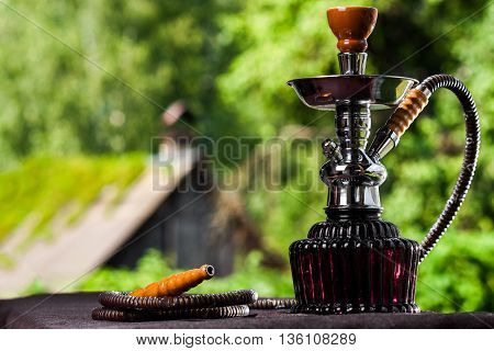Hookah Over The Foliage