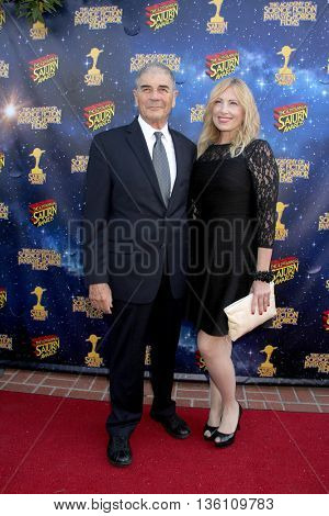 Robert Forrester and guest arrive at the 42nd Annual Saturn Awards on Wednesday, June 22, 2016 at the Castaway Restaurant in Burbank, CA.
