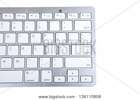 a close up of a white computer keyboard