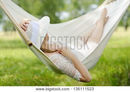 Woman Resting In Hammock Outdoors. Caucasian Woman Relaxing In Hammock.