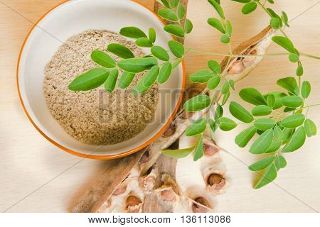 Moringa (Other names are Moringa oleifera Lam. MORINGACEAE Futaba kom hammer vegetable hum hum bug Moringa bug Hoo) grinded leaf and seed powder poster