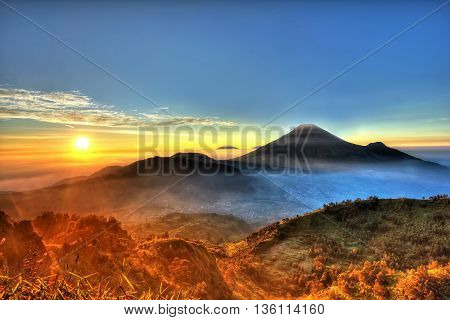 Sunrise from Sikunir's peak. This is a highland at Central Java that you could see many mountains in Central java