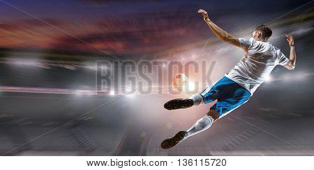 Soccer player hitting ball . Mixed media