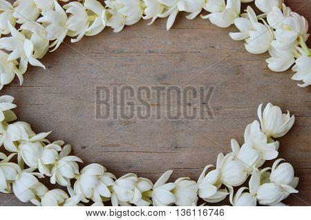 white jasmine curve on wooden board background