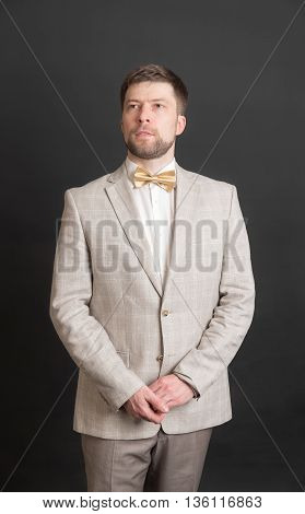 portrait of a man in a suit with a bow tie