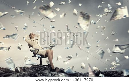 Businesswoman having rest in chair . Mixed media