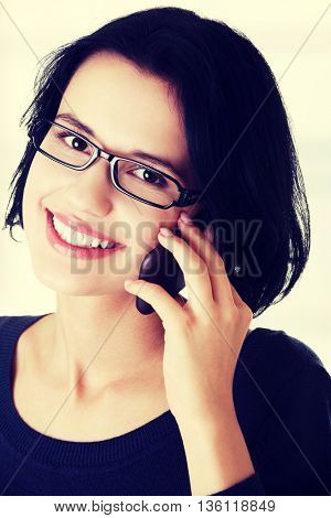 Young happy woman is calling