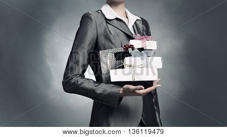 Businesswoman receiving or presenting gifts . Mixed media