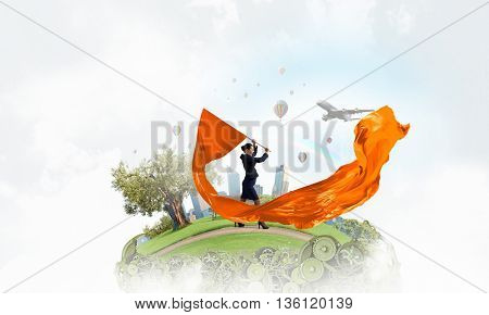 Woman waving yellow flag