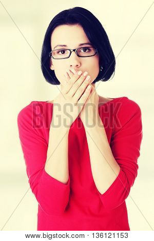 Young woman covering her mouth