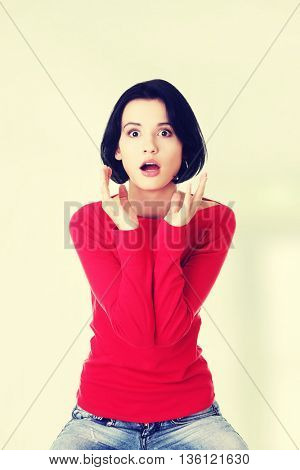 Stressed woman is going crazy in frustration.