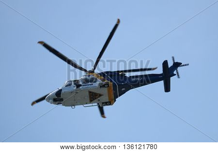 Atlantic City, NJ USA  June 26, 2016  A state police helicopter circling above the marina.