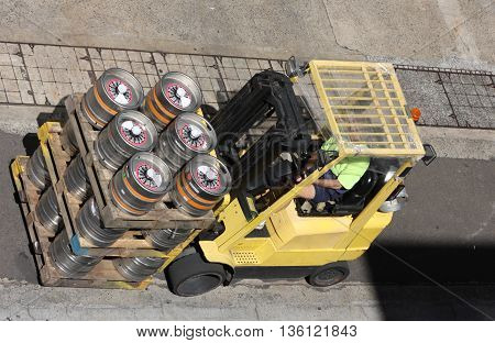 A fork lift with pallets loaded with supply barrels