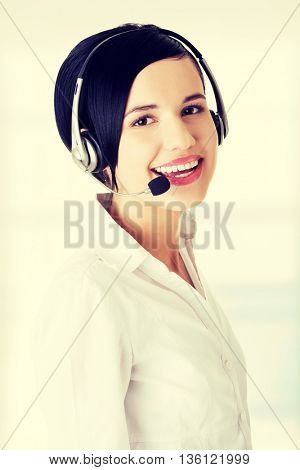 Pretty young call center worker wearing a headset