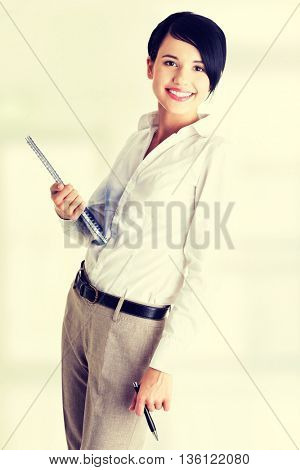 Happy smiling business woman holding notebook and pen