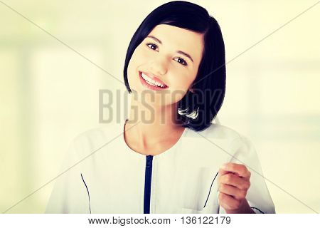 Woman doctor or nurse holding business card