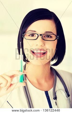 Medical doctor or nurse with syringe