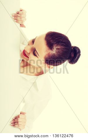 Beautiful young business woman holding copy space.