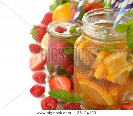 Cold fruit tea on a white background