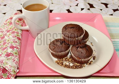 Chocolate muffins and a cup of coffee