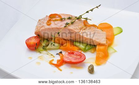 salmon with vegetables served in a restaurant