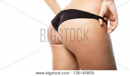 A Young Girl In Her Underwear On A White Background