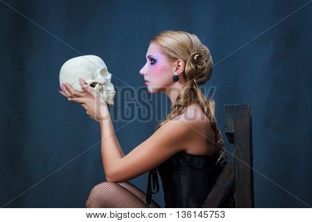Shakespeare's Hamlet female version, woman holding a skull