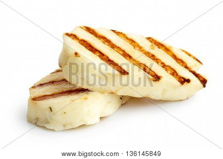 Two Grilled Slices Of Halloumi Cheese Isolated On White In Perspective. With Grill Marks.