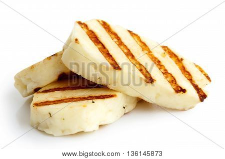 Three Grilled Slices Of Halloumi Cheese Isolated On White In Perspective. With Grill Marks.