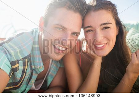 Couple posing together on the beach