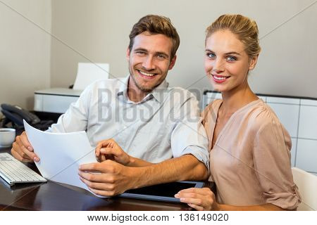 Portrait of smiling happy colleagues working in office