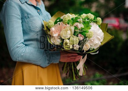 girl holding a bouquet of white flowers no face