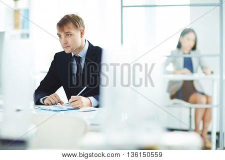 Businessman working at office at his workplace