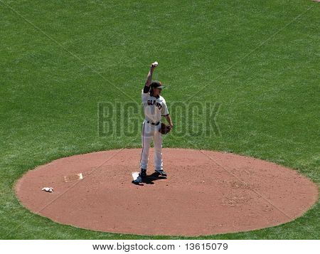 Giants Pitcher Tim Lincecum Lifts Arm To The Sky As He Prepares To Throw A Pitch